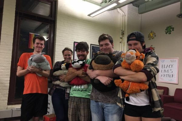 TPS members holding pillow pets