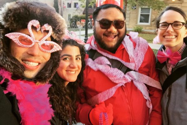Joshua, Gabe, and Katherine in pink flamingo gear at Homecoming 2015