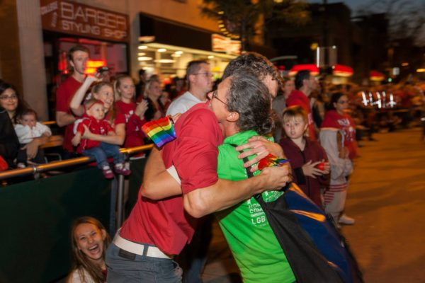 Mo Kappes hugging a parade-goer at Homecoming Parade 2014