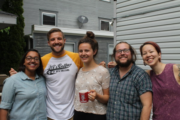 Five grad students smiling in the sun