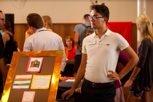 An MBA student tables at our Ice Cream Social